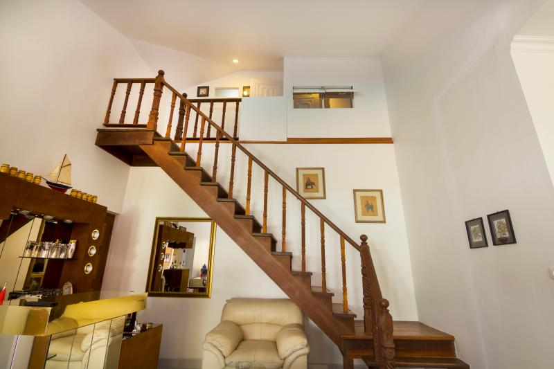 Stairs leading up to the second floor of our property to Top-guestroom, view from entrance door