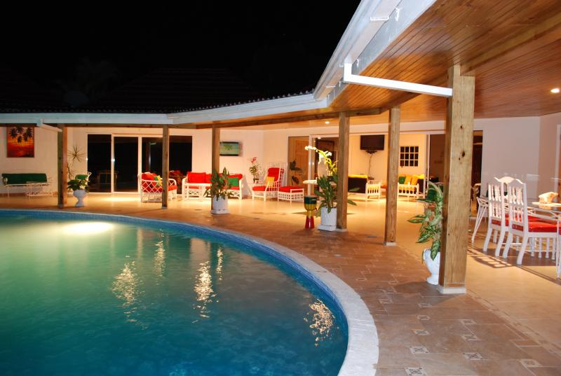 Villa veranda around the pool at night