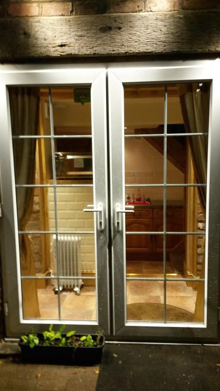 Patio Doors leading through to the Kitchen.