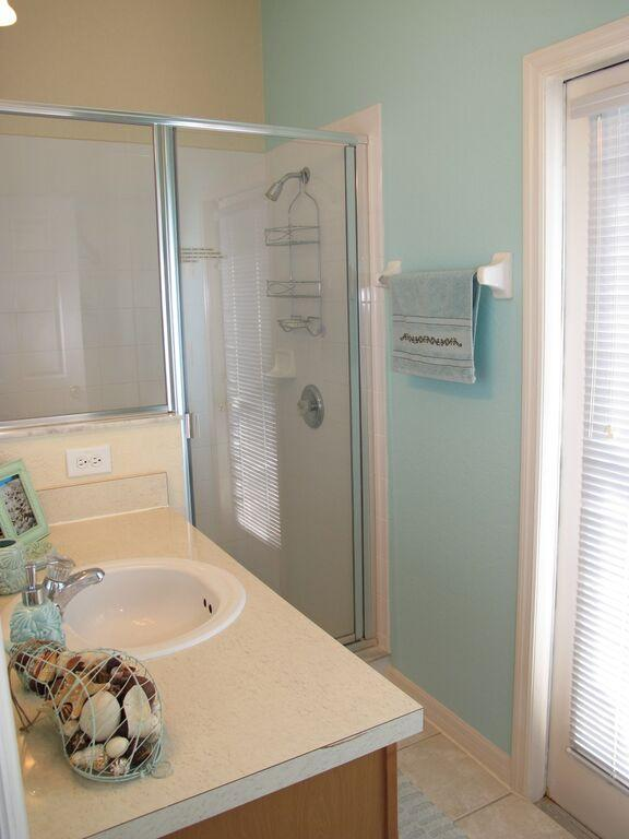 Ensuite bathroom for Master bedroom #2 that has a private door leading to the pool/spa lanai.