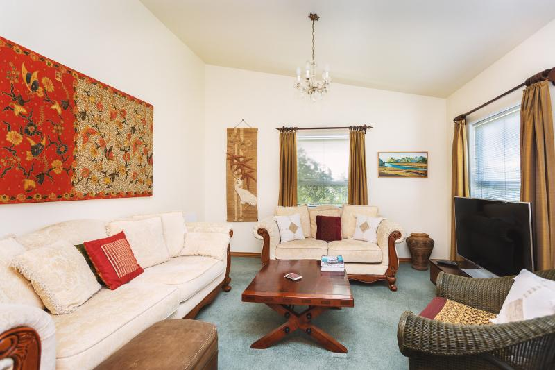 Separate lounge room with deep couches to enjoy TV viewing