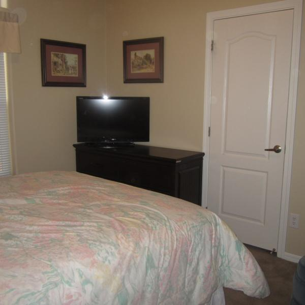 Queen bed in room #2 with a TV