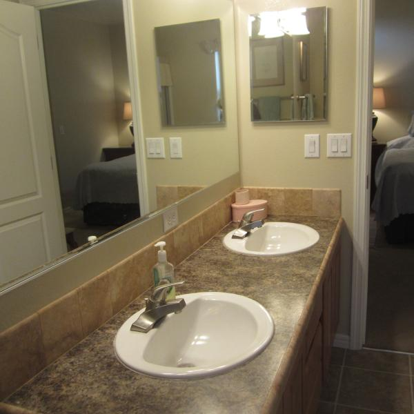Double sink vanity, tub, and shower in the master ensuite