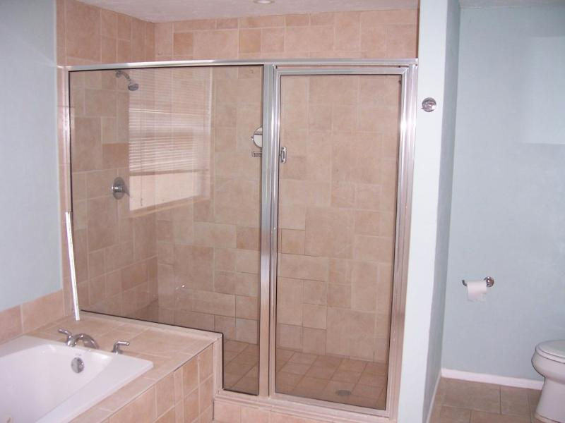 Jumbo shower with two showerheads. Also a jacuzzi.