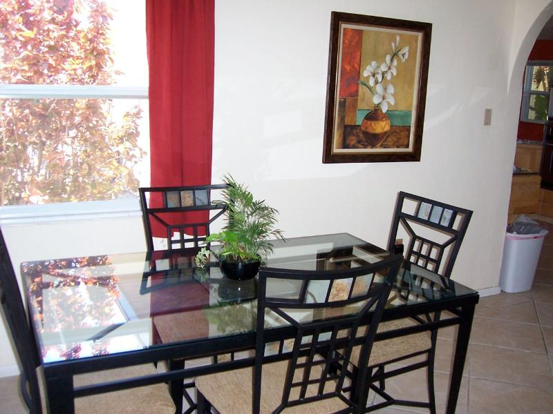 Besides dining area, there is a dining table on the patio and also a kitchen table.
