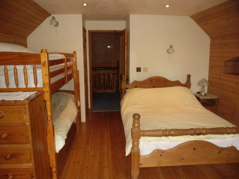 The loft family  bedroom with a double and adult bunk bed , lovely views up the Yarty valley .