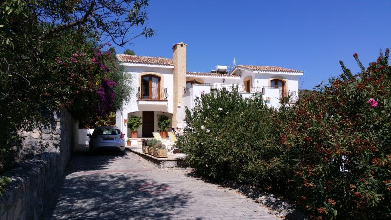 Villa with parking near front door or street level if required. Mature trees and shrubs for privacy