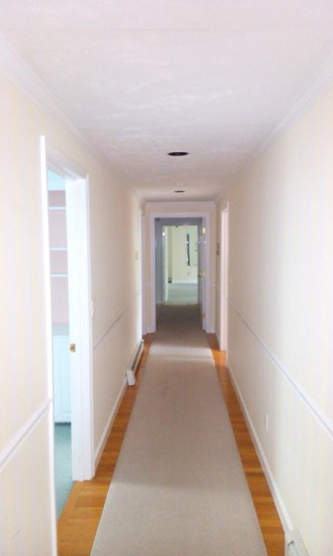 Second Floor Hallway leading to bedrooms, bathrooms and the Gym