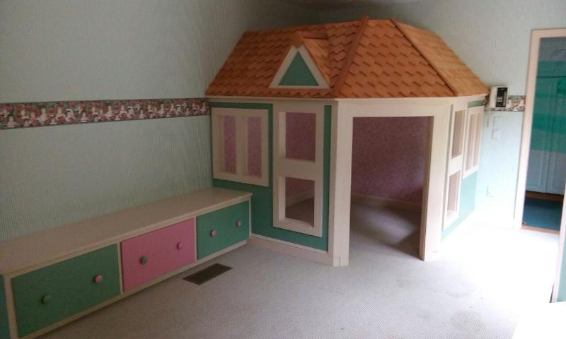 Playroom with life size doll house and adjacent bathroom