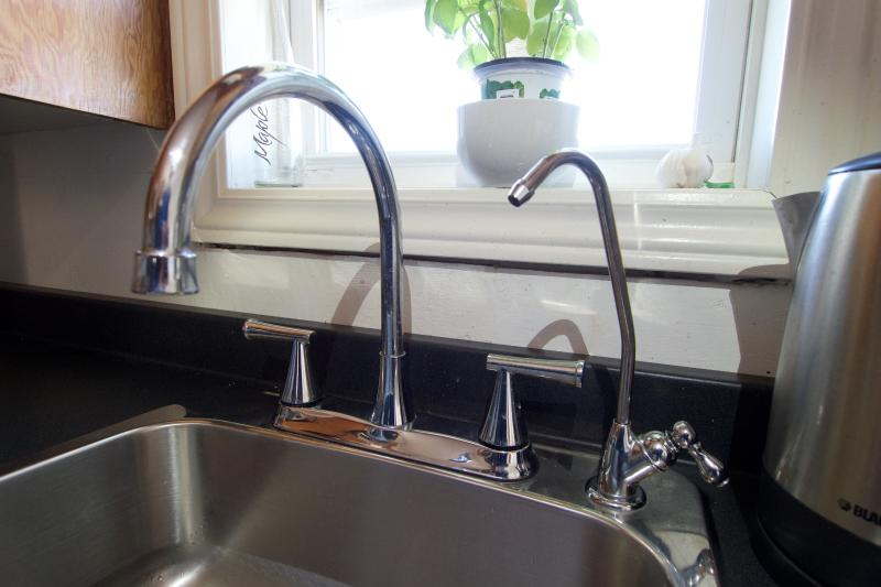 New counter top and sink with drinking water tab (not necessary to buy water bottles)