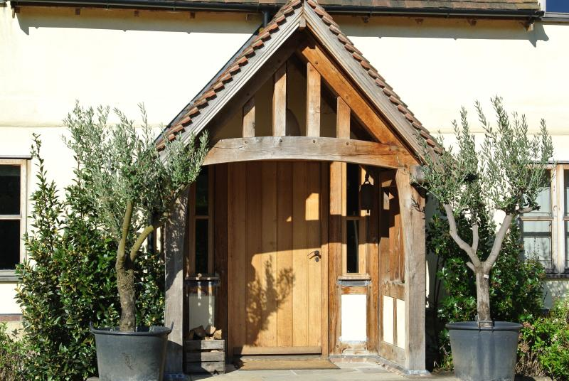 Huge Oak porch with Olive Trees standing guard!