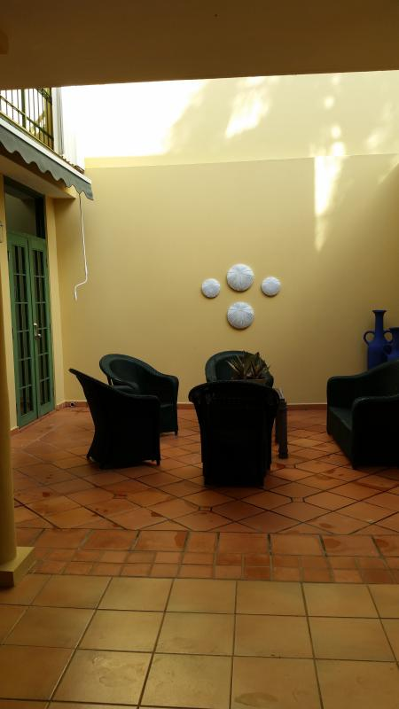 interior terrace, balcony to bedroom above.