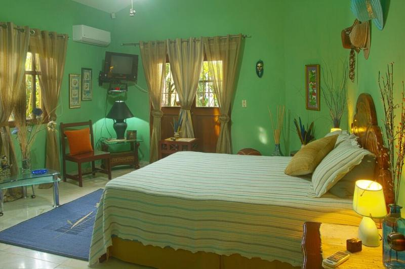 Master Bedroom with access to terrace, TV, AC, fan, night tables with lamps, black out curtains