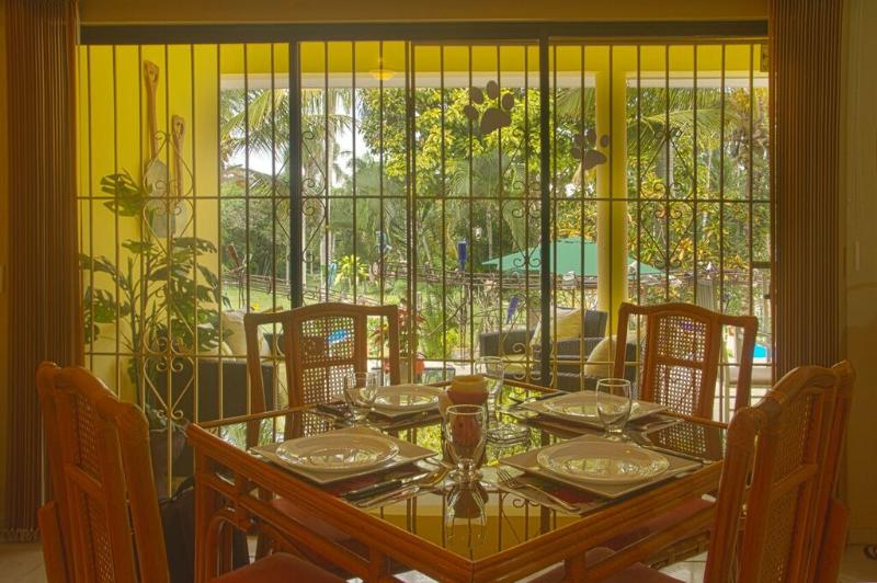 Indoor Dining set for 4, view to pool and terrace