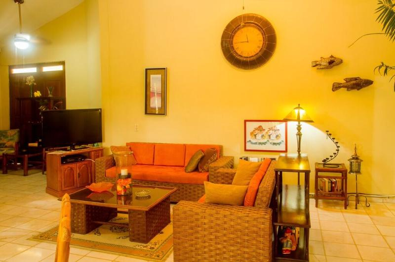 Living room with 2 comfortable sofas, coffee table, 42' TV and stereo.