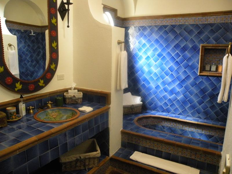 Second master with double sinks, tub and shower combination.