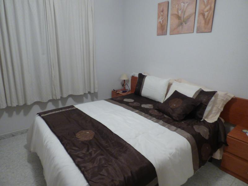 Main bedroom with King size bed, double wardrobe, chest of drawers and bedside units