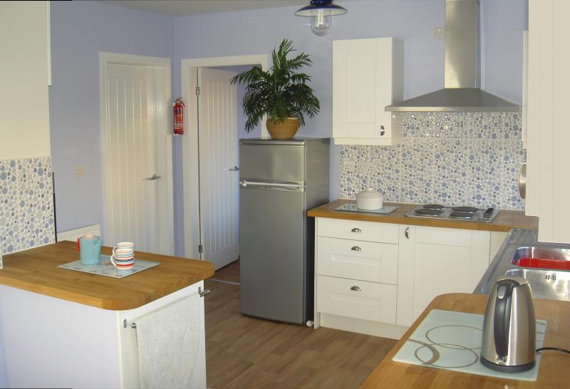 Newly fitted, well equipped eat-in Kitchen with French doors opening to dog secure back garden.