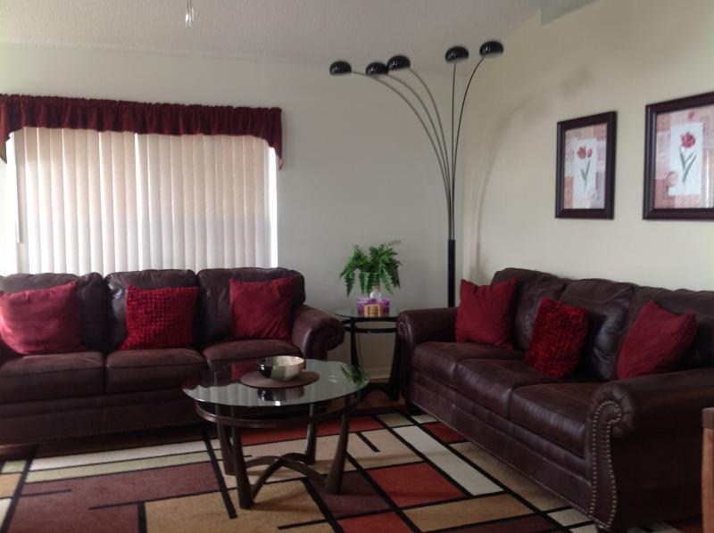 Our spacious, comfortable, triple aspect living room, perfect to relax in.