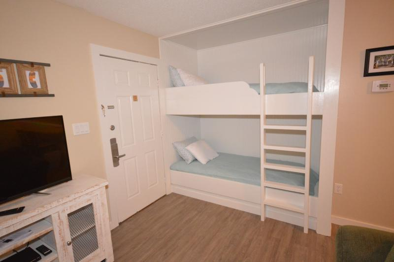 Adult-sized bunks.