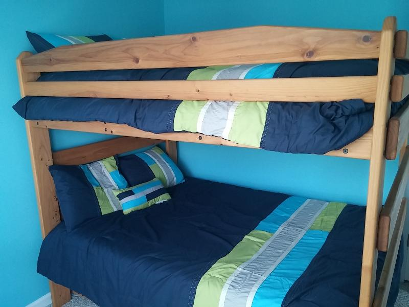 Bedroom 2 with full bunk beds and trundle.