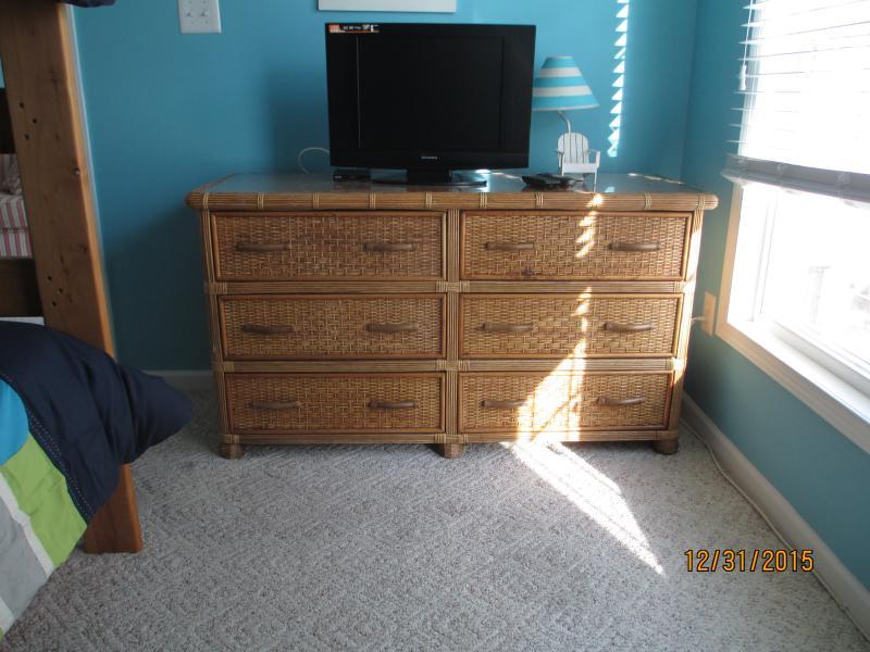 Bedroom 2 dresser and tv.