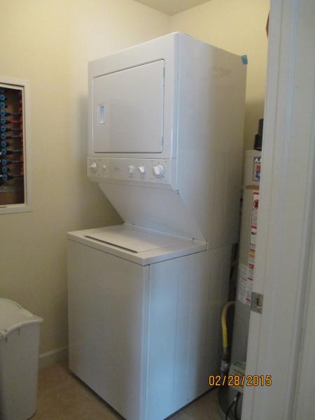 Laundry room in condo.