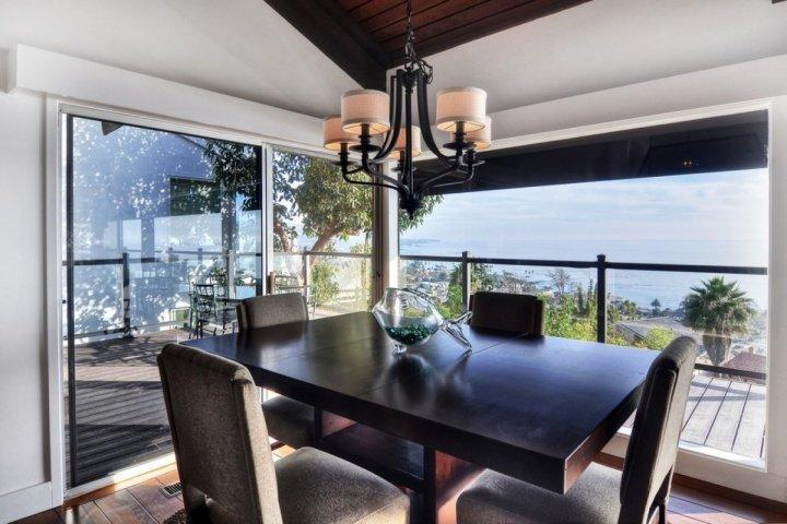 Dining table in corner of living room to capture great ocean views