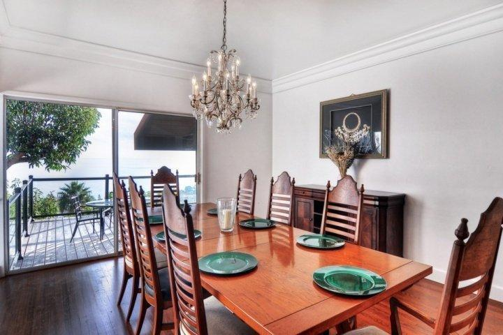 Formal dining room with seating for 8 and ocean views