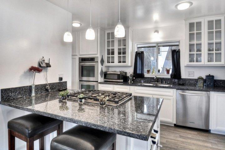 Upgraded kitchen with granite counters, new stainless appliances and gas stove