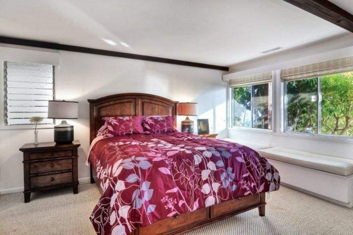 Downstairs bedroom with queen bed and full bathroom