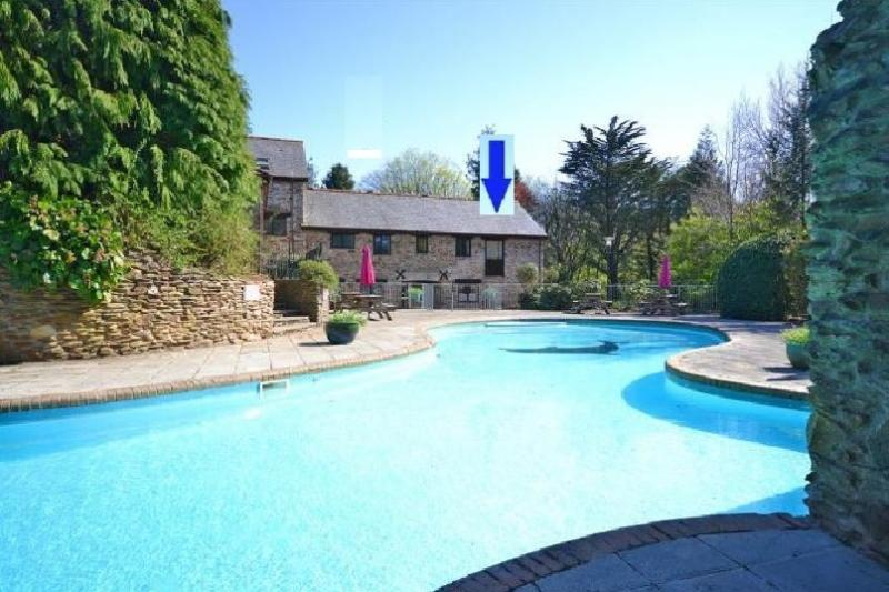 Cottage looks out onto large heated outdoor pool - open May to Sept