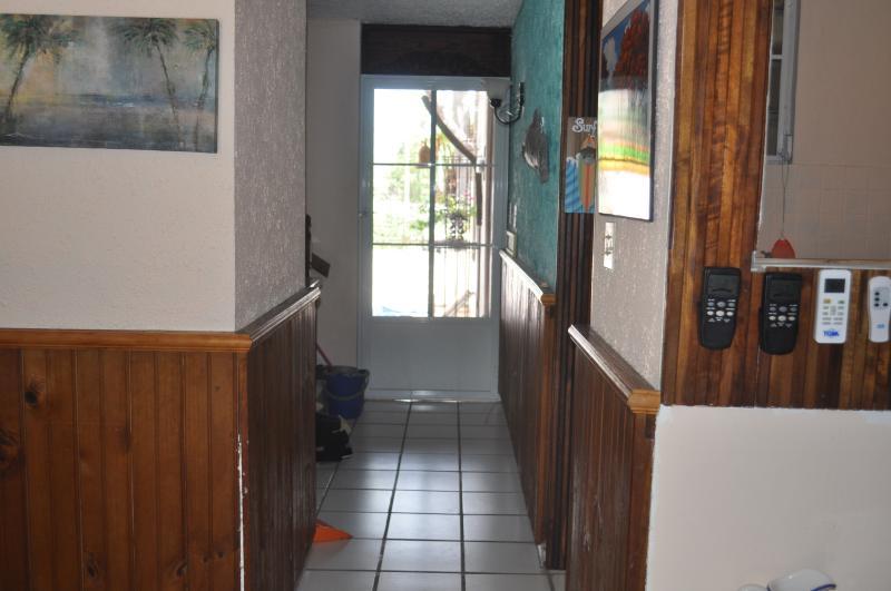 View from inside the house toward outdoor screen door.