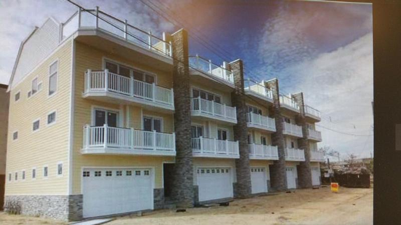 The unit., 2nd from left, is the entire unit, with 2 balconies and a full roof deck