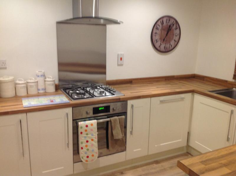 kitchen with all modern appliances fridge freezer washing machine and dishwasher