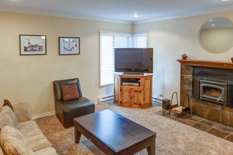 Fireside at The Village #108 - Living room with fireplace and TV