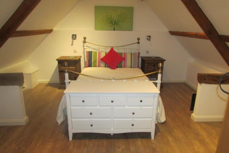 Beamed double bedroom.