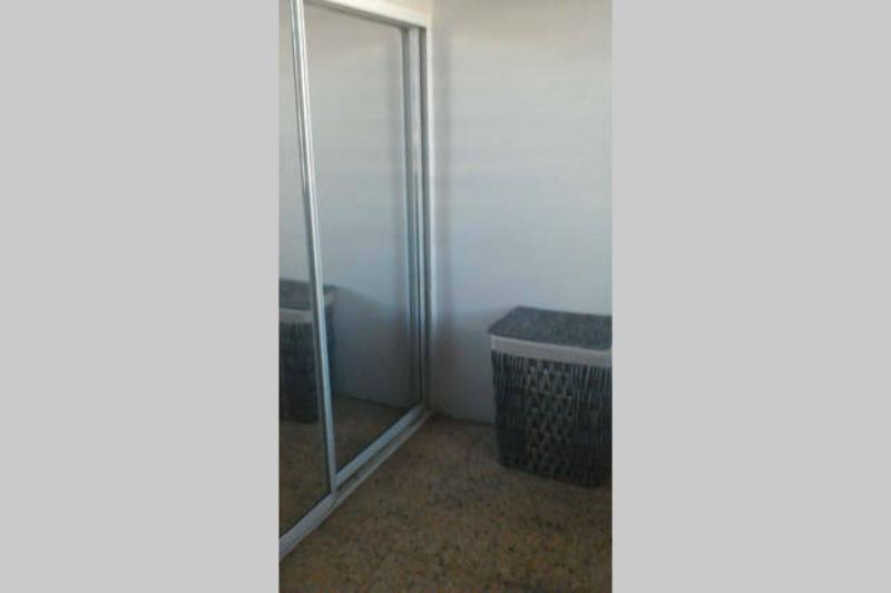 Full sized mirrored closet with all sorts of good stuff--beach chairs, coolers, extra towels.