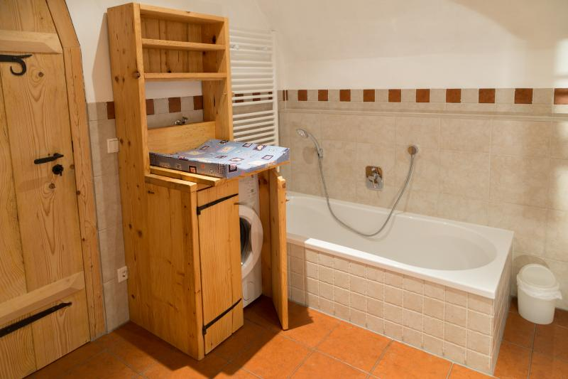 Bathtub with washing machine and changing table