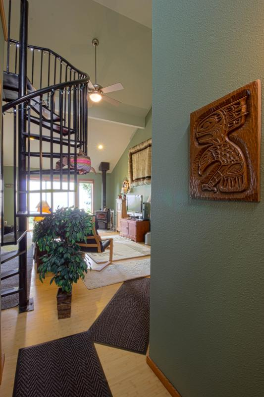 Walk in entry.  Views, art work and hand hewn iron stairs