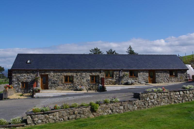 Front view showing Uchaf and Isaf cottage, and part of non working farm yard.