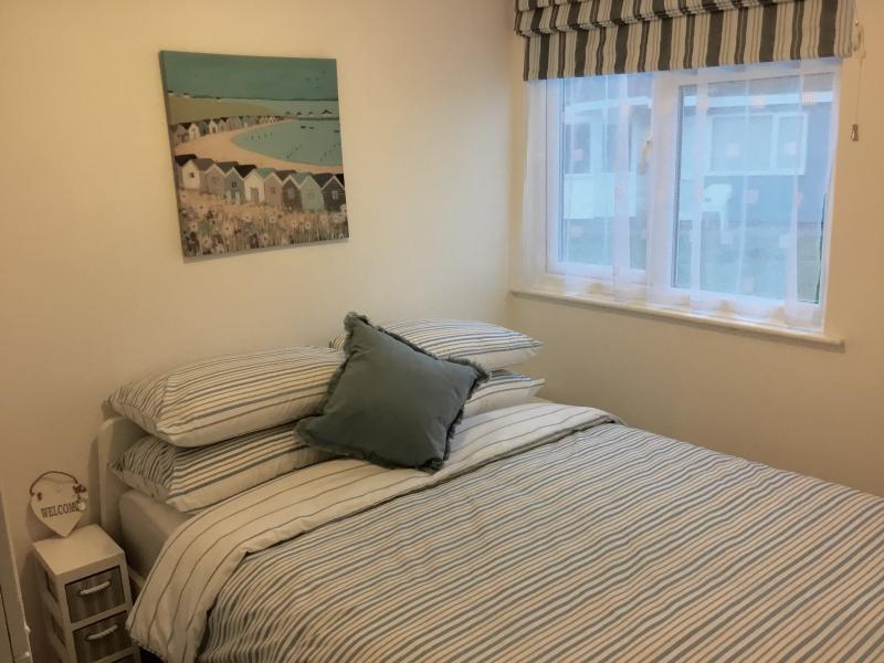 Bedroom with double bed and bedside units