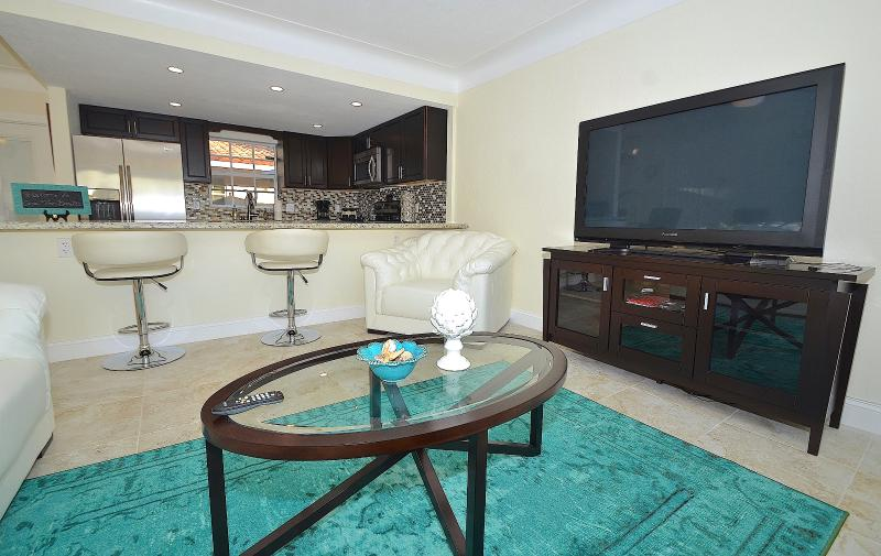 Villa One's Spectacular Open Living Offers Two (2) Leather Sofas + Chair, Counter Dining + LED HD TV