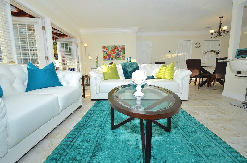 Villa One's Spectacular Open Living Offers Two (2) Leather Sofas + Waterway Dining Access + Views...