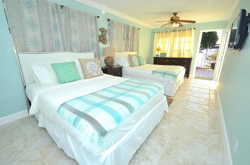 Villa One Spacious (Private) Bedroom Three Offers Two (2) Queen Beds, LED TV + Pool Lounge Access...