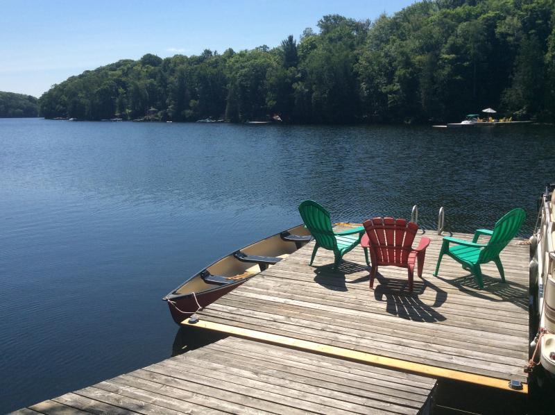 Canoe, Muskoka chairs, and inviting water