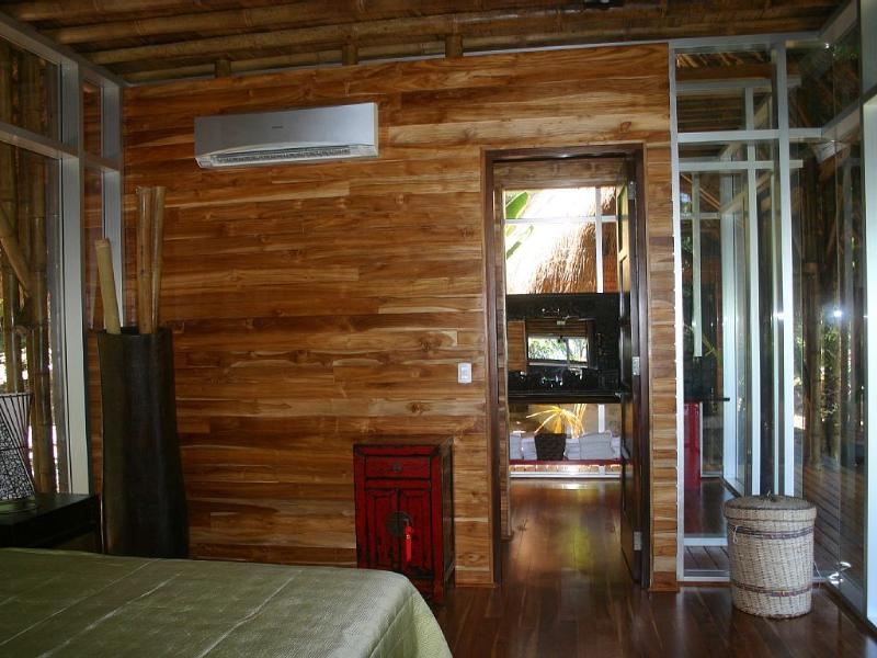 The door leading to attached bathroom, you can see the split AC unit on the wall