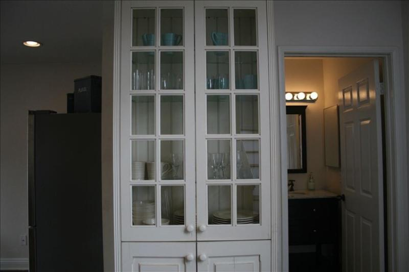 China cabinet and entry to 2nd floor bathroom.