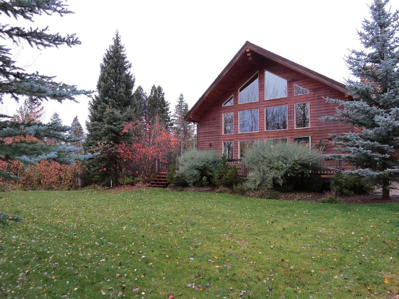 Front yard includes large lawn surrounded by aspen, spruce, fir and hawthorne.