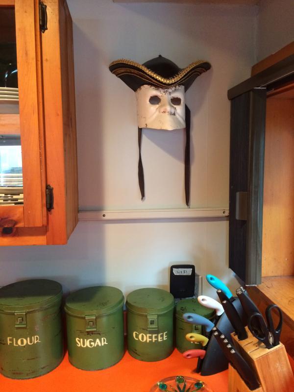 Detail - Venetian mask in kitchen